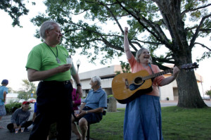 The Rev. Robert Whitehouse and Sharon McDonald sing during the vigil